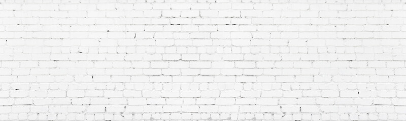 White painted wide brickwork. Whitewashed old shabby exterior brick wall texture. Large long light...