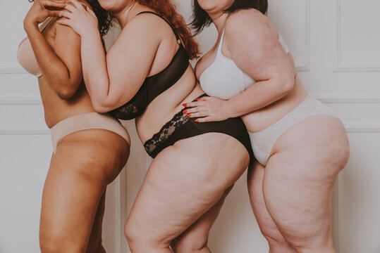 Plus size women posing for body acceptance