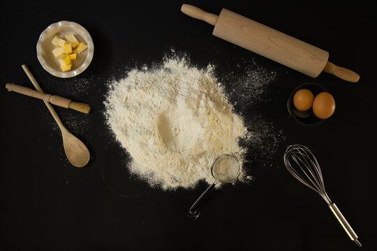 Baking ingredients on a black background