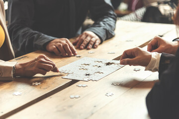 Implement improve puzzel solve connections together with synergy strategy team building organizing connection by trust communication. Hands of stakeholders business trust team holding jigsaw puzzle