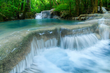 Beautiful deep forest waterfall at Kanchanaburi province, Thailand.