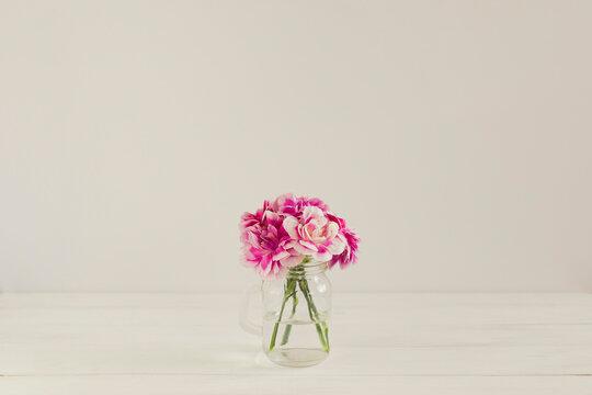 Pink Carnation Flowers in Mini Glass Mason Jar