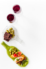 Fototapete - Toasts with prosciutto and tomatoes with red wine top view space for tex