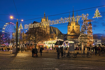 Erfurt, Germany. Christmas market at Domplatz on the background of St Mary's Cathedral and Church of St Severus in twilight.