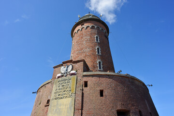 Kolobrzeg, Poland 07-22-2020 historical lighthouse, a landmark and fortress with a plate of the Polish history