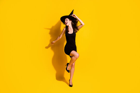 Full length body size view of her she nice attractive pretty skinny chic ecstatic overjoyed cheerful cheery lady dancing having fun chill isolated bright vivid shine vibrant yellow color background