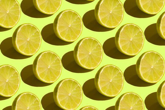 Seamless green pattern of cut limes