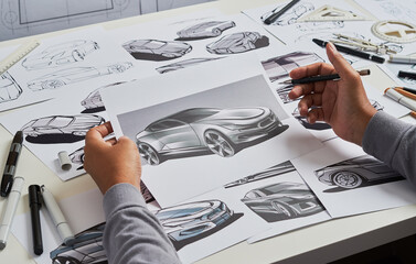 Designer engineer automotive designdrawing sketch development Prototype concept car industrial creative.