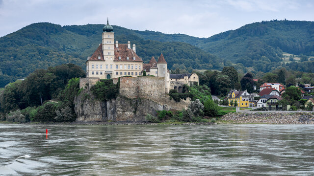 "Gasthof Stumpfer, Austria / Danube River - August 15, 2020: Gasthof Stumpfer and the castle ""Schönbühel"" (situated on a rock)."