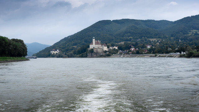 """Gasthof Stumpfer, Austria / Danube River - August 15, 2020: Gasthof Stumpfer and the castle """"Schönbühel"""" (situated on a rock). Camping Stumpfer has a size of 10.000m² see on the right."""