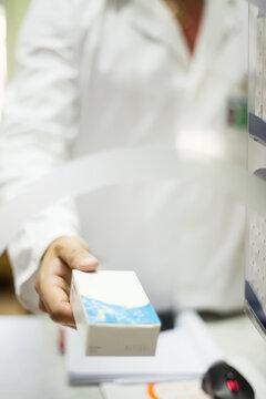 Pharmacist giving medicine to the customer