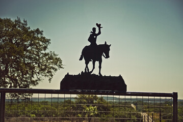 cowboy silhouette tipping hat Texas Hill Country