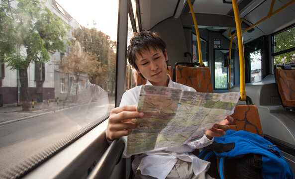 Japanese Tourist Sitting on a City Bus