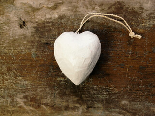 A white heart shaped holiday love ornament