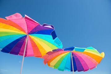 Colorful beach umbrellas against a blue summer sky