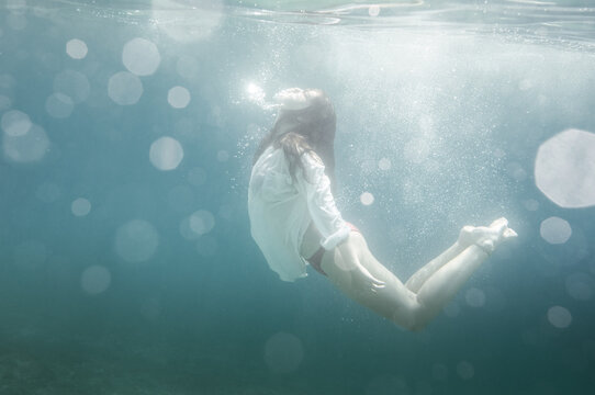 Woman Wearing White Underwater