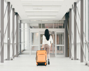Girl with a suitcase in a hallway