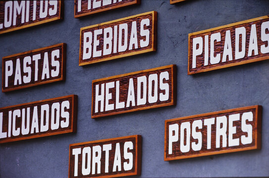 Restaurant sign with South american food and dishes