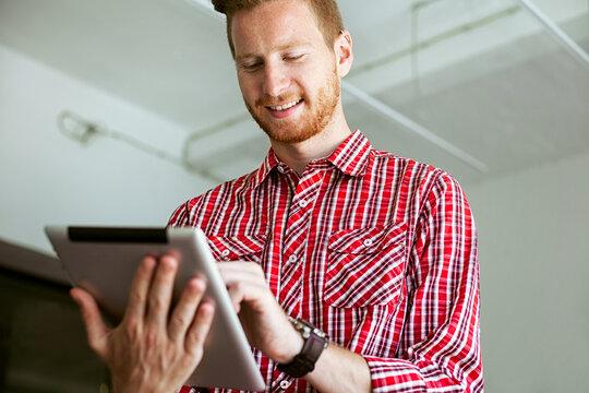 Ginger Businessman Using a Digital Tablet