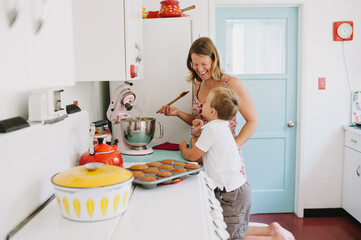 Mother baking with son in cute kitchen