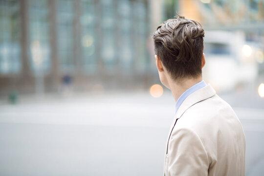 A businessman looking down a city street