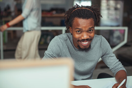 Young African Businessman Working at His Desk