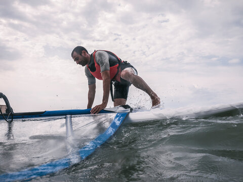 Wind surfer in the sea