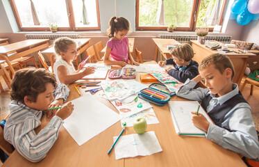 Schoolchildren Drawing in a Classroom