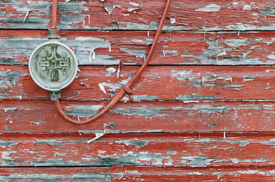 meter on weathered red wall