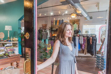 Woman Buys Clothes at a Fashionable Retail Boutique
