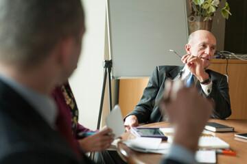 Senior executive leading discussion
