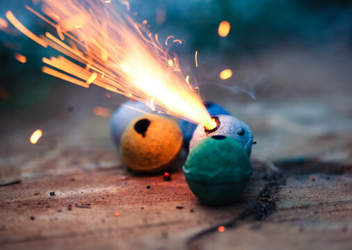 Colorful clay smoke bombs with sparks flying
