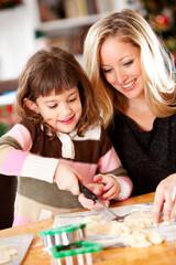 Gingerbread: Girl Gets Cookies Off of Cookie Sheet