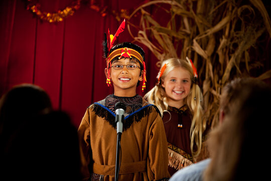 Thanksgiving: American Indian Speaking At Microphone
