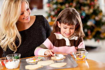 Gingerbread: Daughter Helps to Decorate Cookies