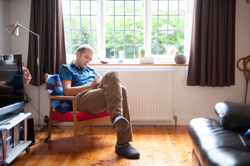 caucasian man by a window
