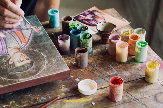 Artist paints icon