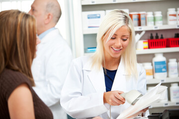 Pharmacy: Pharmacist Helps Customer With Prescription