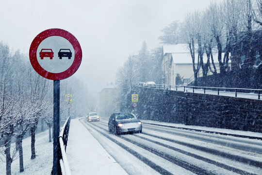 Overtake Forbidden Sign in a Snowy Road
