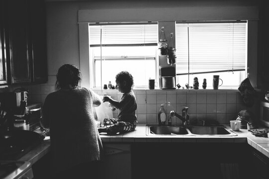 grandmother and grandson cooking