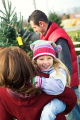 Tree Lot: Little Girl Laughing While Looking For Christmas Tree