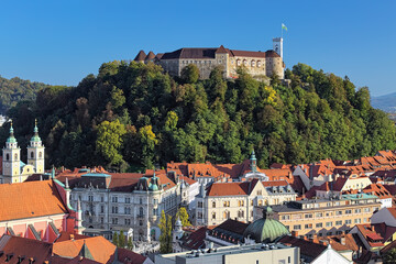 Ljubljana, Slovenia. Ljubljana Castle and historical part of the city in sunny autumn day. View from observation desk at the top floor of the Neboticnik building (The Skyscraper).