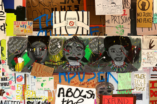 Protest signs hang on a contruction wall at Black Lives Matter Plaza in Washington