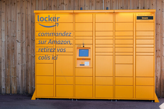Amazon Locker Delivery Store yellow boxes for self-service delivery location to pick up and return parcel