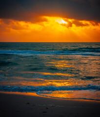 sunset on the beach colors orange sea