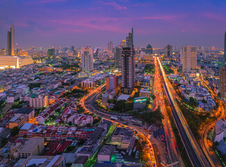 Bangkok cityscape. View of Trident roads in the area of Sathorn and Taksin Bridge at night in Thailand.