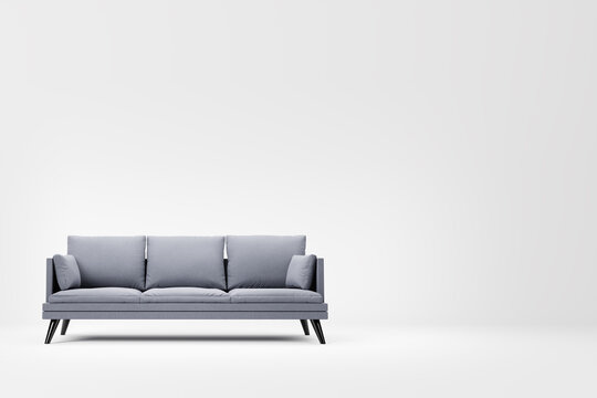 Grey couch with pillows on studio white background.