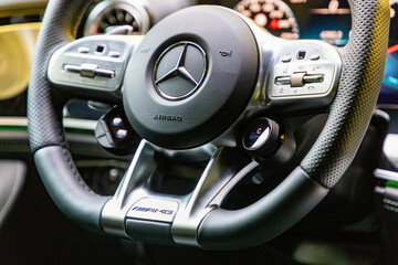 Steering wheel of Mercedes-Benz AMG vehicle in Prague, Czech Republic, August 6, 2020