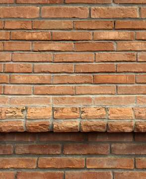 Seamless texture, background wall of red old brick with a ledge. Substrate for design.