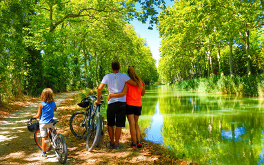 Family with bikes- sport, holiday, family concept France, Canal du Midi